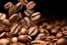A photo of some coffee beans cascading, to illustrate how money falls away as per the latte factor.